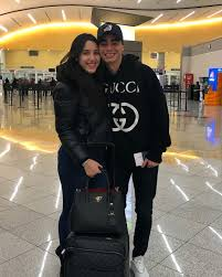 Miguel Almiron's stunning Wag Alexia kisses him goodbye at airport as he  jets off to seal £21m Newcastle switch